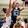 HADLEY GREEN/Staff photo<br /> Hamilton-Wenham's Cecily Szady (23) shoots at the Masconomet v. Hamilton-Wenham girls basketball game at Masconomet High School.