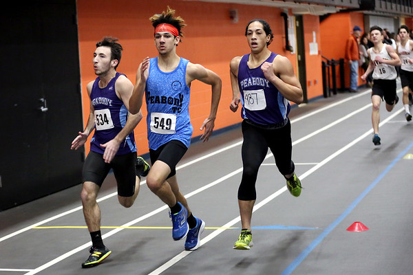 HADLEY GREEN/Staff photo<br /> From left, Peabody's Christian Silva, Elijah White, and Isaiah Knight run at the track meet at Beverly High School.