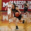HADLEY GREEN/Staff photo<br /> Bishop Fenwick's Sammi Gallant (5) dribbles the ball while Masconomet's Mak Graves (3) plays defense at the Masconomet v. Bishop Fenwick girls basketball game at Masconomet High School.<br /> <br /> 12/23/17