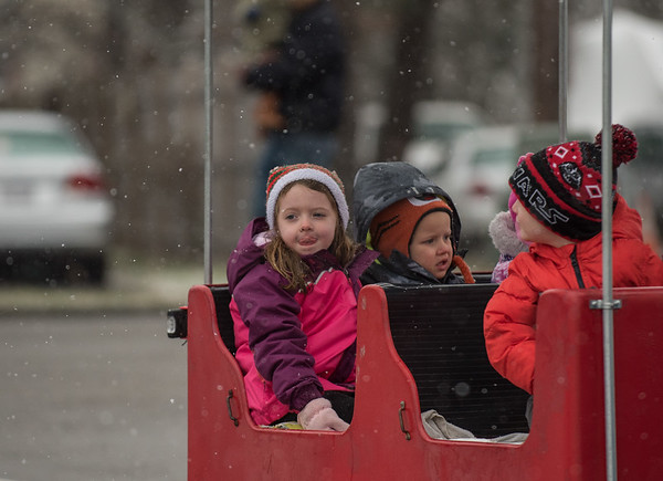 AMANDA SABGA/Staff photo. <br /> <br /> Zoey Bonefant, 4, of Hamilton, rides on the train at the annual Santa by the Sea event at Pope's Landing in Danvers.<br /> <br /> 12/9/17