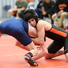 HADLEY GREEN/Staff photo<br /> Beverly's Nick DeJoy and Peabody's Jack Murphy face off at the Beverly v. Peabody wrestling match at Beverly High School.<br /> 12/20/17