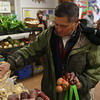 HADLEY GREEN/Staff photo<br /> Gordon Baird of Gloucester looks at vegetables at the Cape Ann Farmer's Market at the Unitarian Universalist Church in Gloucester.<br /> <br /> 12/23/17