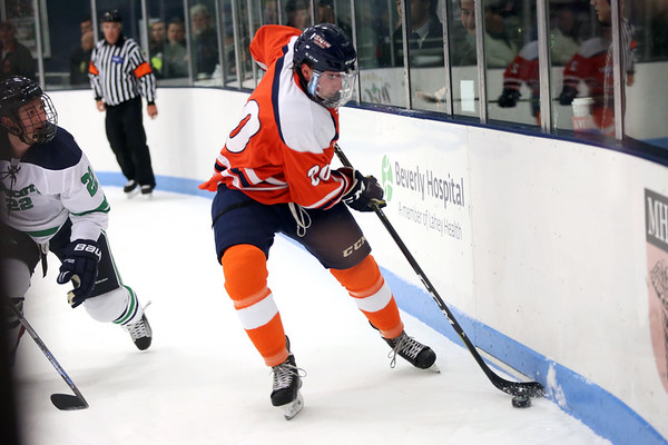 HADLEY GREEN/Staff photo<br /> Salem States's Parker Wood (20) gains control of the puck at the Endicott v. Salem State boys hockey game at Endicott College.