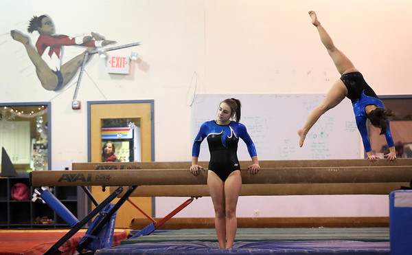 HADLEY GREEN/Staff photo<br /> The Danvers High School gymnastics team practices at Yellow Jackets in Middleton.<br /> <br /> 12/23/17