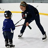 HADLEY GREEN/Staff photo<br /> Meghan Duggan of Danvers helped Brody Hayes, 3, of Danvers on the ice at her fundraiser at Essex Sports Center. <br /> <br /> 12/23/17