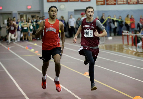 HADLEY GREEN/ Staff photo<br /> Marblehead's Yosef Ngowe and Gloucester's Max Boucher race to the finish of the 300 meter contest at the track meet at Marblehead High School.<br /> <br /> 12/06/2018