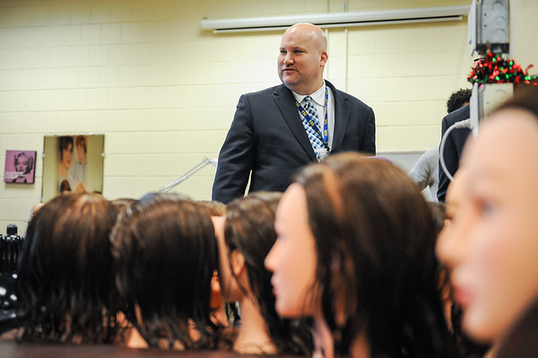 Jeffrey C. Riley, state DESE commissioner, meets with school officials at Peabody High