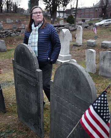 CARL RUSSO/Staff photo. The South Church historian, Charlotte Lyons talks about the history of the graves in the church cemetery.  Students from Penguin Hall Academy in Wenham helped research and discover the likely burial spot in the South Church cemetery in Andover of a woman who was a slave named Lucy Foster in the late 1700s and early 1800s. 12/05/2018