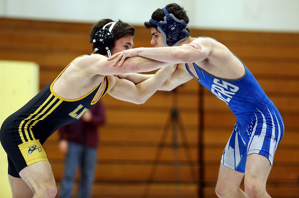 HADLEY GREEN/ Staff photo<br /> Danvers' Devin Viel and Lynnfield/North Reading's Adam Rossetti square off during the 132 pound match at Wednesday night's wrestling match hosted by Danvers High. during Wednesday night's wrestling match at Danvers High.