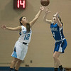 SAM GORESH/Staff photo. Peabodys senior Alyssa Alperen blocks a pass to Danvers senior Nicole White in their game at Peabody High School. 2/3/17