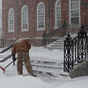 HADLEY GREEN/ Staff photo<br /> Bill Swaczyk shovels the steps of the U.S. Post Office in Salem during Thursday's snowstorm.