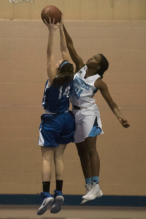 SAM GORESH/Staff photo. Peabody senior Chinenye Onwuogu tries to stop Danvers senior Elena Clifford from getting the rebound in their game at Peabody High School. 2/3/17
