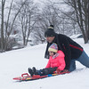 SAM GORESH/Staff photo. Andrew Morency pushes his daughter Gabrielle Morency, 5, down the hill while sledding at Lyons Park. 2/12/17