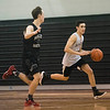 SAM GORESH/Staff photo. Marblehead junior Seamus Keaney races down the court with the ball as junior Will Brooks attempts to stop him on defense during their practice at Marblehead High School. 2/12/17