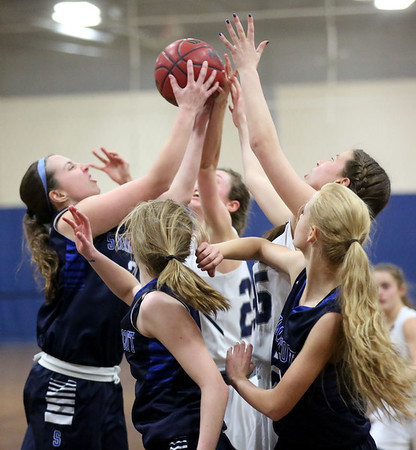 HADLEY GREEN/ Staff photo <br /> Players from both teams vie for a rebound at the Hamilton-Wenham v. Swampscott MIAA State Tournament first round playoff game at Hamilton-Wenham High School on Tuesday, February 28th, 2017.