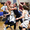 HADLEY GREEN/ Staff photo <br /> Swampscott's Ella Parker (10) goes for a rebound at the Hamilton-Wenham v. Swampscott MIAA State Tournament first round playoff at Hamilton-Wenham High School on Tuesday, February 28th, 2017.