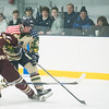 SAM GORESH/Staff photo. St. John's Prep junior Evan Beers fights Newburyport junior Dylan Rogers for the puck in the 1st Lt. Derek Hines Memorial Hockey Game at Essex Sports Center. 2/18/17