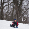 SAM GORESH/Staff photo. Mathew Morency, 9, sleds down the hill at Lyons Park. 2/12/17