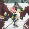 SAM GORESH/Staff photo. St. John's Prep junior Matt Nardone hits the puck in the 1st Lt. Derek Hines Memorial Hockey Game against Newburyport at Essex Sports Center. 2/18/17