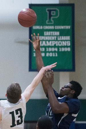 SAM GORESH/Staff photo. Pingree School's Alanzo Jackson prepares to shoot a basket as Concord Academy's even Zak attempts to stop him in their game at the Pingree School. Pingree won the game 68-19. 2/3/17