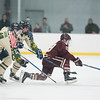 SAM GORESH/Staff photo. Newburyport junior Cole Spence reaches for the puck as St. John's Prep sophomore Joe Bevere and junior Tim Usalis attempt to stop him on defense in the 1st Lt. Derek Hines Memorial Hockey Game at Essex Sports Center. 2/18/17