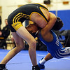 HADLEY GREEN/ Staff photo<br /> Lynnfield/North Reading's Tim Leggett grapples with Danvers' Max Leete during the 120 pound match at Wednesday night's wrestling match hosted by Danvers High.