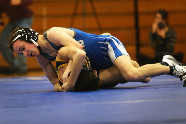 HADLEY GREEN/ Staff photo<br /> Danvers' Matt Gange tries to push Lynnfield/North Reading's Chris Merano to the mat during the 106 pound match at Wednesday night's wrestling match hosted by Danvers High.