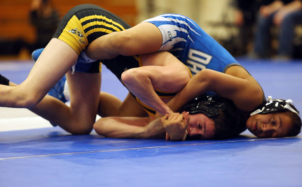 HADLEY GREEN/ Staff photo<br /> Danvers' Max Leete tries to pin Lynnfield/North Reading's Tim Leggett to the mat during the 120 pound match at Wednesday night's wrestling match hosted by Danvers High. during Wednesday night's wrestling match at Danvers High.