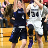 HADLEY GREEN/ Staff photo <br /> Hamilton-Wenham's Elizabeth Kirschner (34) shoots while being guarded by Swampscott's Grace DiGrande (4) at the Hamilton-Wenham v. Swampscott MIAA State Tournament first round playoff game at Hamilton-Wenham High School on Tuesday, February 28th, 2017.