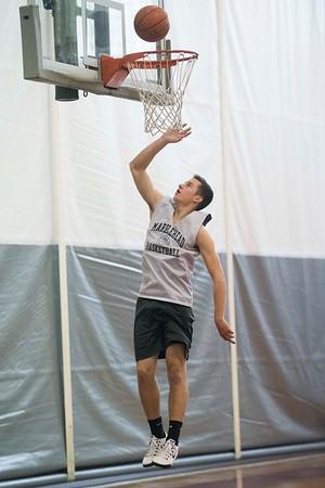 SAM GORESH/Staff photo. Marblehead senior Pat Bugler shoots the ball during the basketball team's practice at Marblehead High School. 2/12/17
