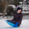 SAM GORESH/Staff photo. Lillian Grant, 11, sleds down the hill at Lyons Park. 2/12/17