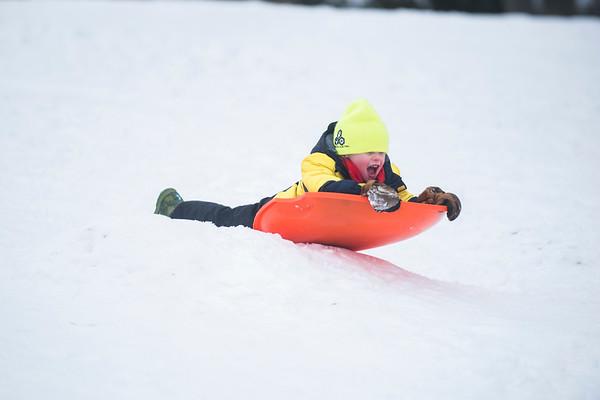 SAM GORESH/Staff photo. Sawyer Carrarini, 5, sleds down the hill at Lyons Park. 2/12/17