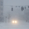 HADLEY GREEN/ Staff photo<br /> A car stops at a red light on the corner of Norman and Washington Street in Salem during Thursday's snowstorm.