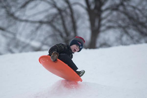 SAM GORESH/Staff photo. Bennett Carrarini, 6, gets some air while sledding at Lyons Park. 2/12/17