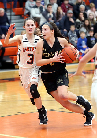 HADLEY GREEN/Staff photo<br /> Bishop Fenwick's Sammi Gallant (5) sprints to the basket while Beverly's Hailey Anderson (3) guards her at the Beverly v. Bishop Fenwick girls basketball game at Beverly High School.<br /> <br /> 02/18/18
