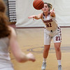 HADLEY GREEN/Staff photo<br /> Gloucester's Claire Knowlton (21) passes the ball at the Gloucester v. Malden girls basketball game at Gloucester High School.<br /> <br /> 02/02/18