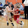 RYAN HUTTON/ Staff photo<br /> MASCO's Makayla Graves drives to the hoop against Bishop Fenwick's Jaxson Nadeau during the first quarter of the Larry MacIntire Tournament final on Monday at Beverly High School.