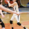 HADLEY GREEN/Staff photo<br /> Beverly's Hailey Anderson (3) passes the ball at the Beverly v. Bishop Fenwick girls basketball game at Beverly High School.<br /> <br /> 02/18/18