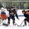 CARL RUSSO/Staff photo. Marblehead's captain, Grace Moroney, right moves the puck in front of Masco.'s net. From left, Masco.'s goalie, Molly Elmore and Meghan McElaney, 4 and Marblehead's captain, Sydney Cresta fight for postion. Masconomet vs. Marblehead in girls hockey Division 1 preliminary round playoff game.  2/27/2018
