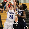 HADLEY GREEN/Staff photo<br /> Danvers' Jonathan Weimert (20) shoots while Swampscott's Andrew Augustin (35) guards him at the Danvers v. Swampscott boys basketball game at Danvers High School.<br /> <br /> 02/13/18