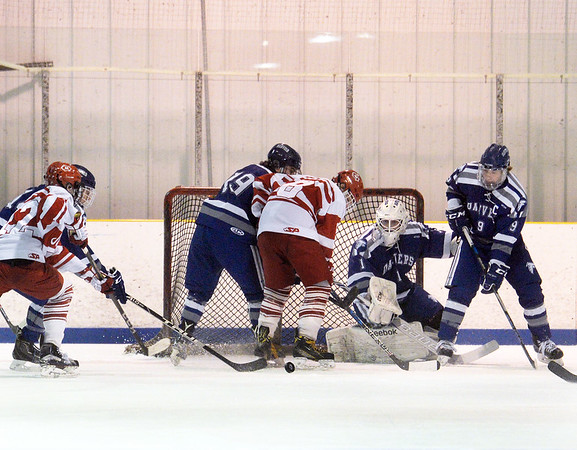 CARL RUSSO/Staff photo SALEM NEWS: Danver's goalie, Yegor Bublik makes the save as Masconomet players scramble for the rebound. Masconomet high school vs Danvers high school in boys varsity hockey action. 2/12/2018