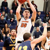 HADLEY GREEN/Staff photo<br /> Salem State's Drew Healy (35) shoots at the Salem State v. MCLA boys basketball game at Salem State University.<br /> <br /> 02/14/18