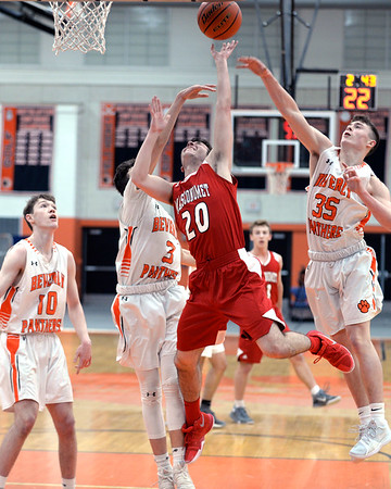 RYAN HUTTON/ Staff photo<br /> MASCO's William Schena goes up for a shot on the Beverly hoop during the first quarter of the Larry McIntire Classic at Beverly High School on Monday.