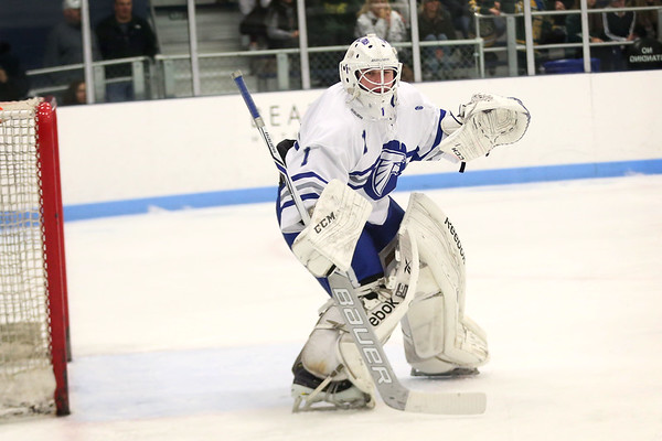 HADLEY GREEN/Staff photo<br /> Danvers goalie Yegor Bublik (1) guards the net at the Danvers v. North Reading boys hockey game at Endicott College. <br /> <br /> 02/23/18
