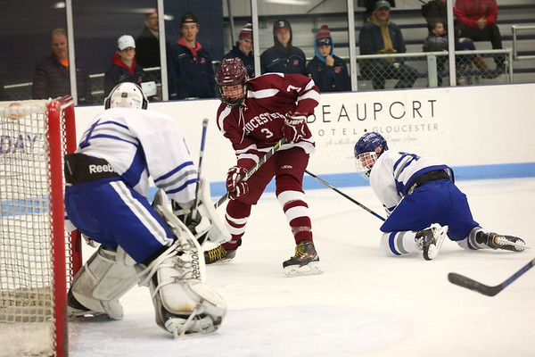 HADLEY GREEN/Staff photo<br /> Gloucester's EJ Field (3) shoots at the Danvers v. Gloucester boys hockey game at Endicott College.<br /> <br /> 02/09/18