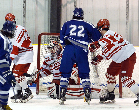 CARL RUSSO/Staff photo SALEM NEWS: Masconomet's goalie, Tucker Hanson goes down to make the save with his right pad at the start of the second period in Hockey action. Masconomet high school vs Danvers high school in boys varsity hockey action. 2/12/2018