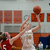 RYAN HUTTON/ Staff photo<br /> Bishop Fenwick's Jennie Meagher goes up to the hoop over the head of MASCO's Paige Amyouny during the second quarter of the Larry MacIntire Tournament final on Monday at Beverly High School.