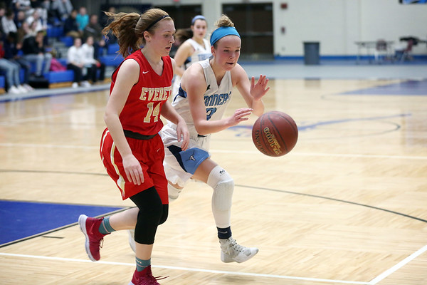 HADLEY GREEN/Staff photo<br /> Peabody's Catherine Manning (3) goes after the ball while Everett's Maddy Duraes (14) plays defense at the Peabody v. Everett girls basketball game at Peabody High School.<br /> <br /> 02/08/18