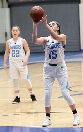 HADLEY GREEN/Staff photo<br /> Peabody's Amber Kiricoples (15) shoots a free throw at the Peabody v. Swampscott girls basketball game at Peabody High School.<br /> <br /> 02/15/18