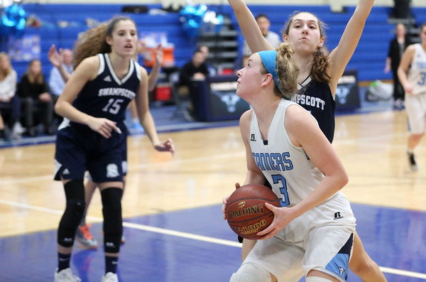 HADLEY GREEN/Staff photo<br /> Peabody's Catherine Manning (3) looks to the basket at the Peabody v. Swampscott girls basketball game at Peabody High School.<br /> <br /> 02/15/18